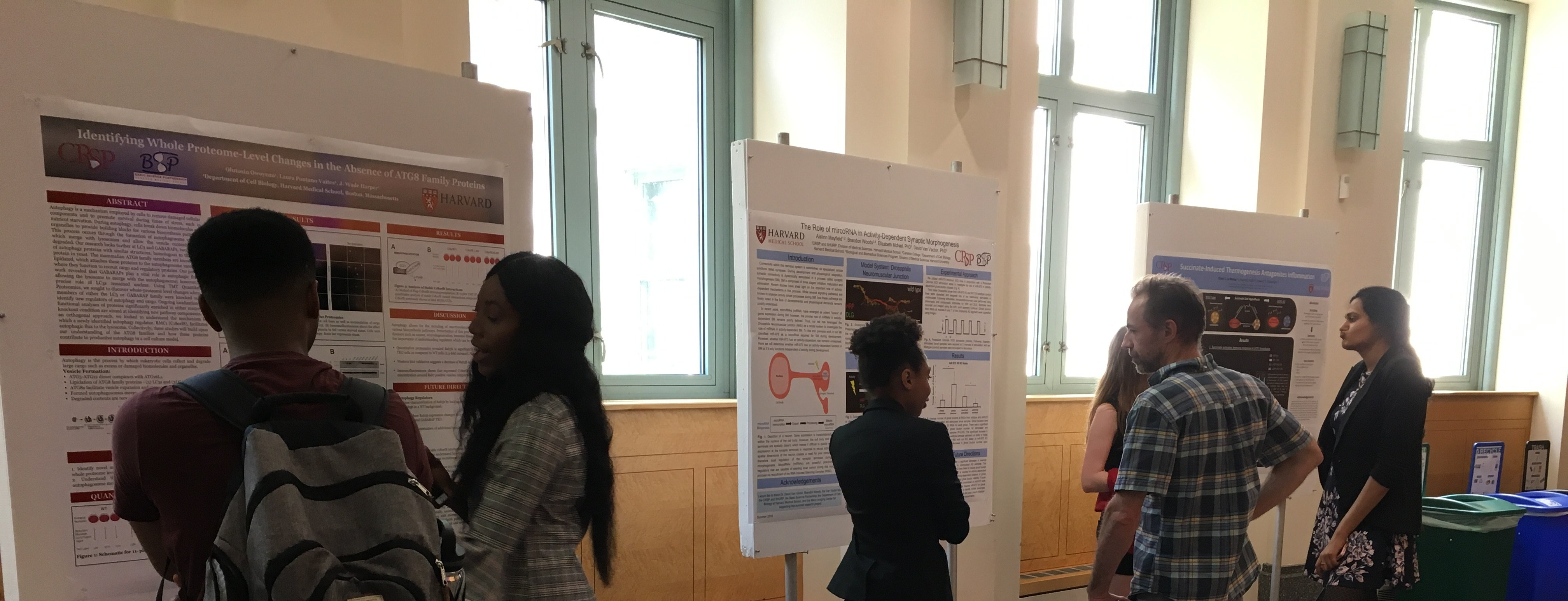 CRSP students present their summer research at a poster session.
